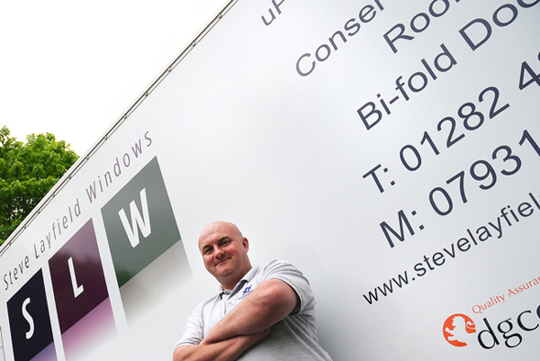 Image showing Steve Layfield standing in front of one of his signwritten company vans